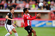 Reuben Reid (33) of Exeter City shields the ball from Alex Woodyard (30) of Lincoln City during the EFL Sky Bet League 2 match between Exeter City and Lincoln City at St James' Park, Exeter, England on 19 August 2017. Photo by Graham Hunt.