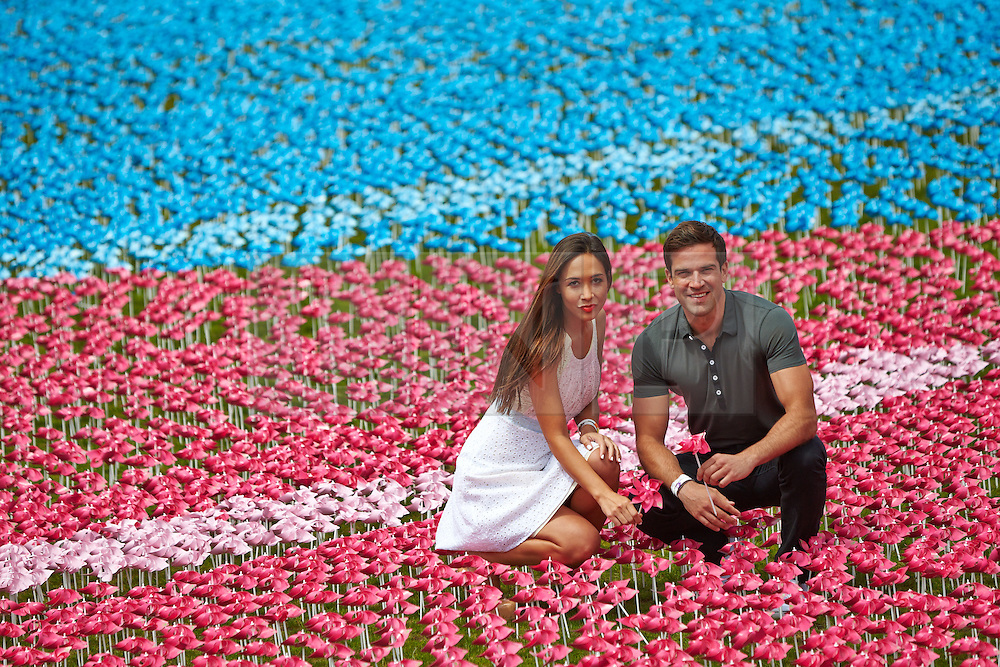 © Licensed to London News Pictures.  08/06/2013. LONDON, UK. Myleene Klass (pictured left) and Gethin Jones (pictured right) help create the Big IF installation in Hyde Park. Consisting of paper flowers each petal is meant to represent the millions of children who die each year from malnutrition. A number of charities have combined to hold a rally demanding that G8 leaders take action to tackle global hunger.  Photo credit: Cliff Hide/LNP