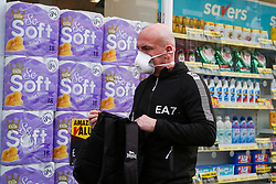 © Licensed to London News Pictures. 14/03/2020. London, UK. A shoppers wearing face mask arrives in Savers, north London to buy toilet rolls. 798 cases have been tested positive and 11 patients have died from the virus in the UK. Photo credit: Dinendra Haria/LNP
