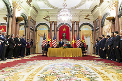 February 27, 2019 - Hanoi, Vietnam - U.S President DONALD TRUMP and Vietnamese President NGUYEN PHU TRONG look on as American and Vietnam corporate executives sign a series of agreements at the Commercial Trade Signing Ceremony in the Mirror Room of the Presidential Palace in Hanoi, Vietnam. (Credit Image: © Shealah Craighead/The White House via ZUMA Wire)