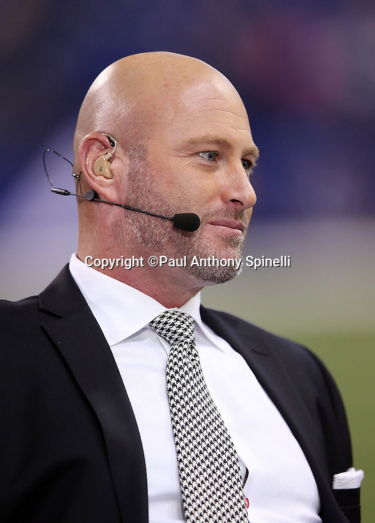 Sports analyst and former Tampa Bay Buccaneers quarterback Trent Dilfer appears on the set of the ESPN field level television broadcast during the Indianapolis Colts 2015 NFL week 2 regular season football game against the New York Jets on Monday, Sept. 21, 2015 in Indianapolis. The Jets won the game 20-7. (©Paul Anthony Spinelli)