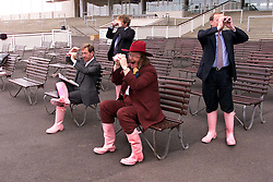 Channel four racing commentator's Derek Thompson (left), John Francome (middle) and John McCririck (hat) all sporting Thomas Pink wellington boots,2000. Photo By Andrew Parsons / i-Images