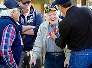 """At Jackson's Town Square Memorial Day cermeony Monday, Vietnam veteran Ed Leipzeit pins a """"Buddy Poppy"""" on William Bates, 89, a World War II veteran who served in the 8th Airforce in 1943 and 1944 as an aerial gunner flying 30 missions over occupied Europe."""