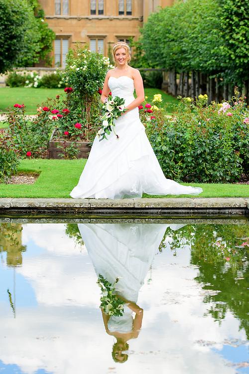Bride reflection in Knebworth House Gardens, Stevenage, Hertfordshire.