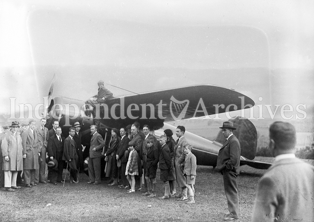 Miss Amelia Earhart - Atlantic Flier at Derry. Sitting on aircraft, circa 1930's<br /> (Part of the Independent Newspapers Ireland/NLI Collection)
