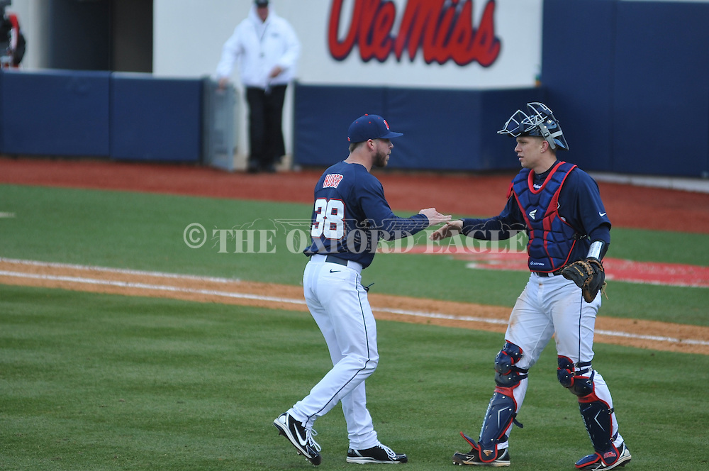 Ole Miss' Brett Huber (38) and catcher Stuart Turner (26) celebrate following a win vs. TCU at Oxford-University Stadium on Saturday, February 16, 2013. Ole Miss won 5-2. Huber picked up his second save of the season.