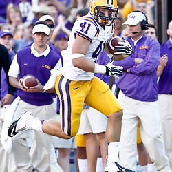 November 17, 2012; Baton Rouge, LA, USA  LSU Tigers tight end Travis Dickson (41) against the Ole Miss Rebels during a game at Tiger Stadium. LSU defeated Ole Miss 41-35. Mandatory Credit: Derick E. Hingle-US PRESSWIRE