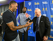 Mick Cronin, right, chats with Cincinnati and NBA star Kenyon Martin, left, and Ronald Allen, who played for Cronin at Cincinnati from 2005 to 2007, after Cronin was introduced as the UCLA Bruins new head basketball coach at a news conference on the campus in Los Angeles Wednesday, April 10, 2019. Cronin was hired as UCLA's basketball coach Tuesday, ending a bumpy, months-long search to find a replacement for the fired Steve Alford. The university said Cronin agreed to a $24 million, six-year deal. (Dylan Stewart/Image of Sport)