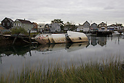 Among a handful of abandoned properties along Hawtree Basin, sits an abandoned boat in Howard Beach in October 2015.<br />