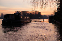 © Licensed to London News Pictures. 12/01/2014. Reading, Berkshire, UK. Sunrise on the Thames Path in Reading, Berkshire. The River Thames has broken its banks causing extensive flooding. Photo credit : Rob Arnold/LNP