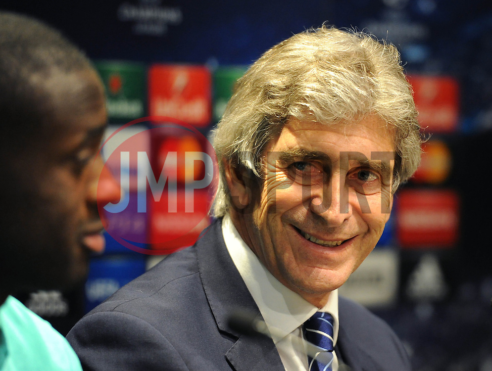 Manchester City's Yaya Toure speaks at the press conference ahead of his sides match against Barcelona in the Champions League - Photo mandatory by-line: Dougie Allward/JMP - Mobile: 07966 386802 - 17/03/2015 - SPORT - Football - Barcelona - W Barcelona Hotel - Manchester City Press Conference - Round of 16 - Second Leg