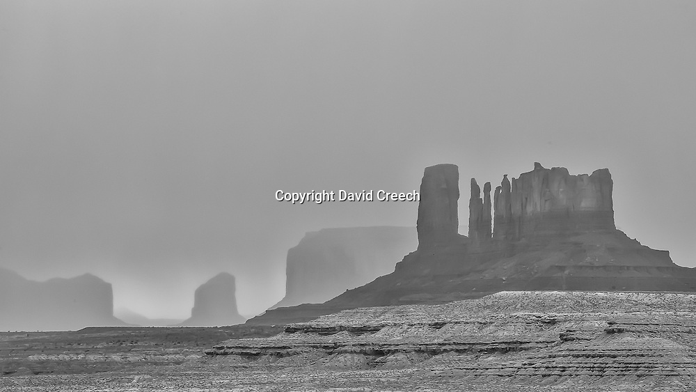 Black and White study of a late season storm rolling through Monument Valley, Utah.
