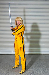 """© Licensed to London News Pictures. 14/03/2015. Newham, London, UK.  A man dressed as Uma Thurman's character from the movie """"Kill Bill"""", one of many cosplayers attending the London Comic Con at the Excel Centre in Docklands. Photo credit : Stephen Chung/LNP"""