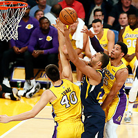 10 October 2017: Utah Jazz center Rudy Gobert (27) goes for the layup against Los Angeles Lakers center Ivica Zubac (40) past Los Angeles Lakers guard Josh Hart (5) during the Utah Jazz 105-99 victory over the LA Lakers, at the Staples Center, Los Angeles, California, USA.