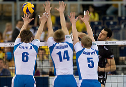 Evgeniy Sivozhelez, Dmitry Shcherbinin and Sergey Grankin of Dinamo vs Matey Kaziyski of Trentino at  final match of CEV Indesit Champions League FINAL FOUR tournament between Dinamo Moscow, RUS and Trentino BetClic, ITA on May 2, 2010, at Arena Atlas, Lodz, Poland. Trentino defeated Dinamo 3-0 and became Winner of the Champions League. (Photo by Vid Ponikvar / Sportida)