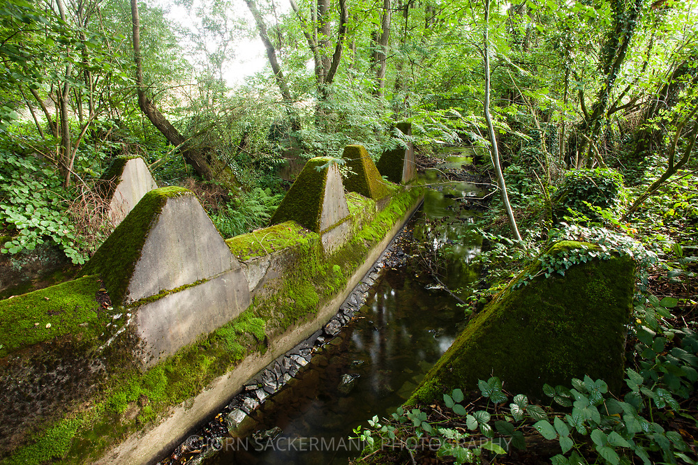 tank traps of the Siegfried line in the river Inde near Schmithof in the south of Aachen, North Rhine-Westphalia, Germany.<br /> <br /> Panzersperren des Westwall im Fluss Inde bei Schmithof im Sueden Aachens, Nordrhein-Westfalen, Deutschland.