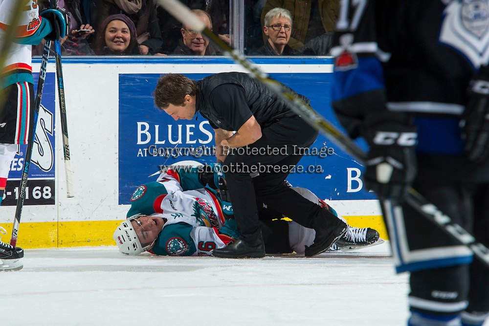 KELOWNA, CANADA - DECEMBER 30: Kelowna Rockets' Athletic therapist, Scott Hoyer, attends to Liam Kindree #26 on the ice against the Victoria Royals  on December 30, 2017 at Prospera Place in Kelowna, British Columbia, Canada.  (Photo by Marissa Baecker/Shoot the Breeze)  *** Local Caption ***