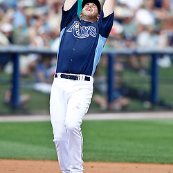 March 21, 2012; Port Charlotte, FL, USA; Tampa Bay Rays third baseman Evan Longoria (3) catches a fly ball during a spring training game against the New York Yankees at Charlotte Sports Park.  Mandatory Credit: Derick E. Hingle-US PRESSWIRE