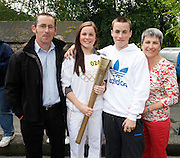 No fee for Repro: 06/06/2012.Sports Management and Coaching Student at ITB (Institute of Technology Blanchardstown) and Irish International Women's Soccer player Niamh Reid Burke of Raheny United is pictured with her parents and brother as she prepairs to take part in historic Olympic Torch Relay through Dublin. Pic Andres Poveda.