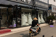 Shops selling western style wedding gowns in Suzhou, China. Suzhou is one of the largest producers of wedding dresses in the world.