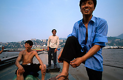 CHINA SICHUAN PROVINCE CHONGQUING MAY99 - Dockworkers take a cigarette break at the shore of the Yangtse river where it merges with the Jailing river at Chongquing. Seven large cities, including Chongquing, and thousands of villages will be submerged once the water level rises after the completion of the controversial Three Gorges Dam project further downriver. The flooding of areas reaching back more than 550Km upriver will require the evacuation and resettlement of more than 10 million people.  jre/Photo by Jiri Rezac. © Jiri Rezac 1999. . Contact: +44 (0) 7050 110 417. Mobile:  +44 (0) 7801 337 683. Office:  +44 (0) 20 8968 9635. . Email:   jiri@jirirezac.com. Web:     www.jirirezac.com