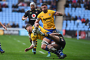 Bath back row Mike Williams (6) is tackled during the Gallagher Premiership Rugby match between Wasps and Bath Rugby at the Ricoh Arena, Coventry, England on 2 November 2019.