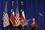 Hillary Clinton lays her hand over her heart let tin the audience know how much she appreciates her while she speaks at the Inaugural Barbara Jordan Gold Medallion Awards at Texas Southern University in Houston on June 4, 2015  (Thomas Shea / Getty Images)