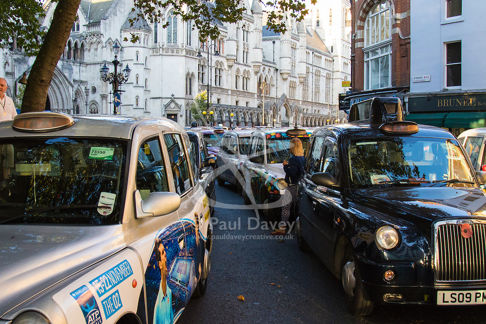 "Black taxi drivers from the United Cabbies Group (UCG) bring Fleet Street to a standstill as they protest ""fairer enforcement of taxi and private hire vehicle regulations, which cover minicabs and Uber cars""."