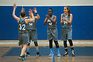 South Burlington's Liz Sargent (14), Allie Bosley (12) and Elizabeth Khosravi (24) greet Willow Yager (32) during player introductions before the start of the girls basketball game between the South Burlington Rebels and the Burlington Sea Horses at Burlington High School on Tuesday night Febraury 2, 2016 in Burlington. (BRIAN JENKINS/for the FREE PRESS)