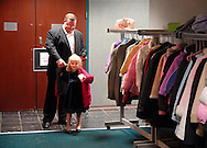 6 FEB. 2010 -- ST. PETERS, Mo. -- Dan Bozell (left) helps his daughter Ellie, 6, with her coat after the Father-Daughter Sweetheart Dance at St. Peters City Hall Saturday, Feb. 6, 2010 in St. Peters, Mo. Photo © copyright by Sid Hasting