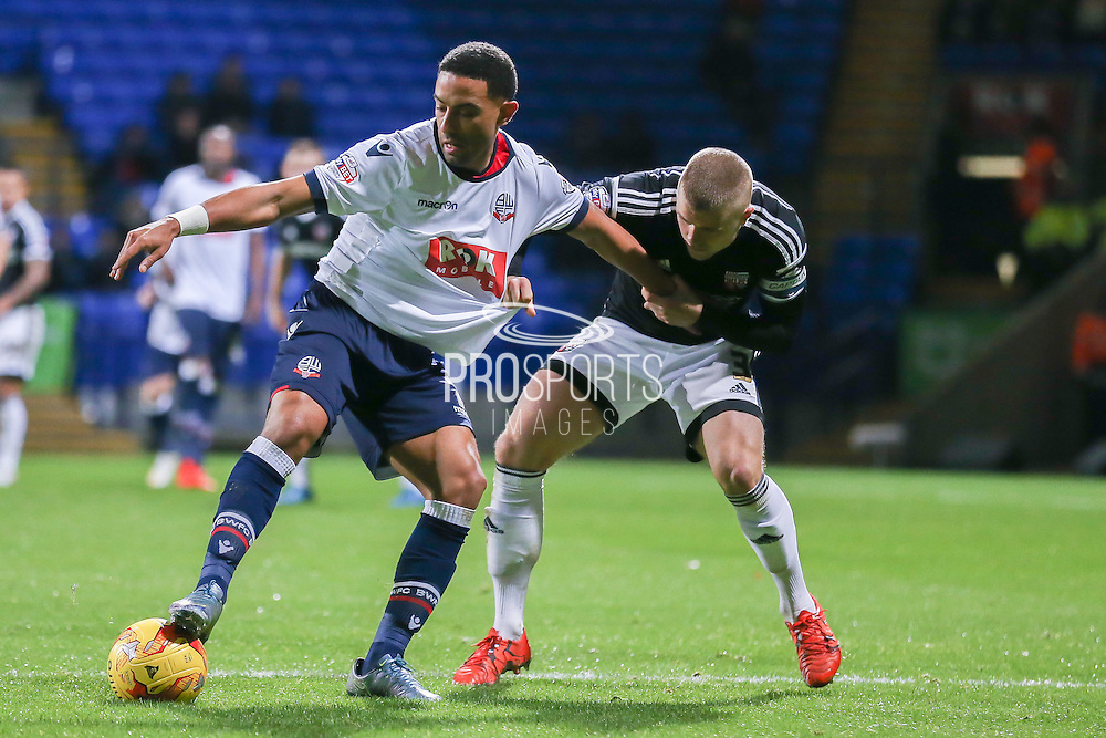 Bolton Wanderers midfielder Liam Feeney  and Brentford defender Jake Bidwell  during the Sky Bet Championship match between Bolton Wanderers and Brentford at the Macron Stadium, Bolton, England on 30 November 2015. Photo by Simon Davies.