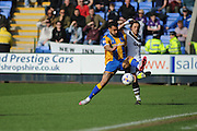 Sam Foley of Port Vale FC under pressure fromKyle Vassell of Shrewsbury Town (on loan from Peterborough United) during the Sky Bet League 1 match between Shrewsbury Town and Port Vale at Greenhous Meadow, Shrewsbury, England on 25 March 2016. Photo by Mike Sheridan.