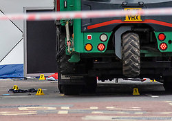 © Licensed to London News Pictures. 15/08/2018. London, UK. Evidence markers are seen beneath a lorry at the scene of an accident at Holborn where a cyclist has died after being hit by a lorry - believed to be former doctor to the Queen Peter Fisher. Photo credit: Rob Pinney/LNP