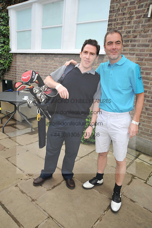 Left to right, ROB BRYDON and JAMES NESBITT at the Mini Masters Golf tournament in aid of LEUKA - London's celebrity golf tournament held at Duke's Meadow Golf Club, Dan Mason Drive, London W4 on 17th July 2009.