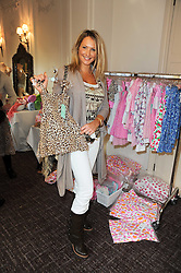 ADELA KING at a shopping afternoon hosted by Amanda Kyme and Tamara Beckwith featuring designs from Elizabeth Hurley held at the Cadogan Hotel, 75 Sloane Street, London SW1 on 23rd November 2010.