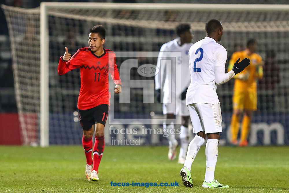 Jose David Ramirez Garcia of Mexico U20 (left) celebrates after he scores against England U20 to make it 0-1 during the International Friendly match at The Hive Stadium, Harrow<br /> Picture by David Horn/Focus Images Ltd +44 7545 970036<br /> 25/03/2015