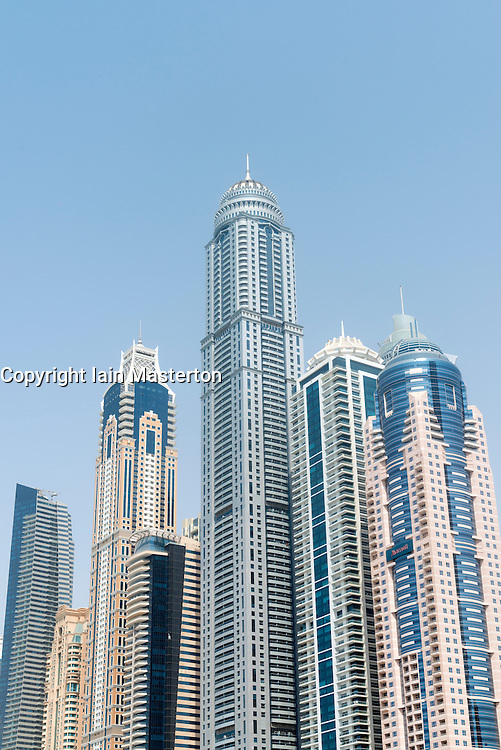 Modern high rise skyscrapers with Princess Tower world's tallest residential building in Marina district of Dubai United Arab Emirates