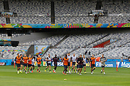 The England team warm up during the England training session the day before their final Group D match against Costa Rica at Mineirão, Belo Horizonte, Brazil. <br /> Picture by Andrew Tobin/Focus Images Ltd +44 7710 761829<br /> 23/06/2014