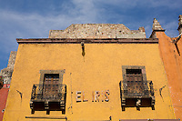 A building facing Umaran street leading to the city center of San Miguel de Allende, Mexico.