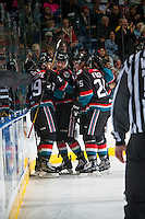 KELOWNA, CANADA - OCTOBER 21: Nolan Foote #29, Cal Foote #25 and Cal Foote #25 of the Kelowna Rockets celebrate a goal against the Tri-City Americans on October 21, 2016 at Prospera Place in Kelowna, British Columbia, Canada.  (Photo by Marissa Baecker/Shoot the Breeze)  *** Local Caption ***