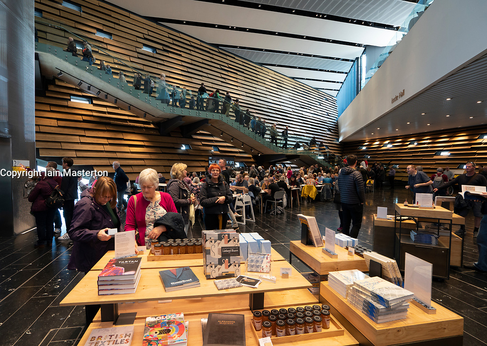 Visitor shop at  the new V&A Museum on first weekend after opening in Dundee , Scotland, UK.