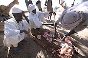 The Breidjing Refugee Camp, Eastern Chad on the Sudanese border shelters 30,000 people who have fled their homes in Darfur, Sudan. In the camp market, freshly slaughtered meat is sold for the festival of Eid al-Fitr, marking the end of the month long fast for Ramadan.(Supporting image from the project Hungry Planet: What the World Eats.)
