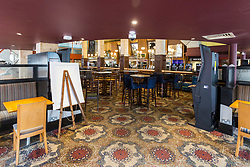 © Licensed to London News Pictures. 21/03/2020. Leeds UK. Inside the Beckett's Bank Wetherspoon pub in Leeds city centre that has been closed due to the Covid 19 outbreak. Photo credit: Andrew McCaren/LNP