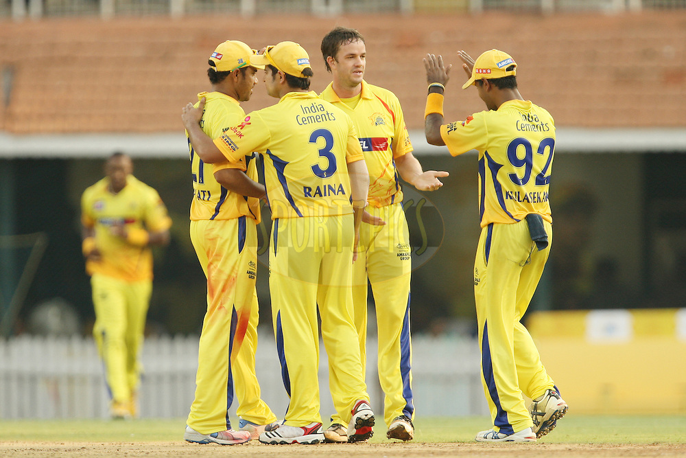 CSK players congratulate Albie Morkel on taking the wicket of David Hussey during match 37 of the the Indian Premier League ( IPL) 2012  between The Chennai Superkings and the Kings XIP held at the M. A. Chidambaram Stadium, Chennai on the 28th April 2012..Photo by Jacques Rossouw/IPL/SPORTZPICS