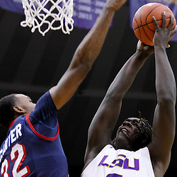 November 23, 2011; Baton Rouge, LA; South Alabama Jaguars forward Javier Carter (32) blocks a shot by LSU Tigers forward Johnny O'Bryant (2) during the first half of a game at the Pete Maravich Assembly Center.  Mandatory Credit: Derick E. Hingle-US PRESSWIRE
