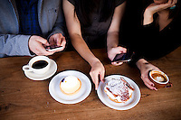 (L-R) Ted Grubb, 30, Alexa Andrzejewski, 27, and Soraya Darabi, 27, sit with cappuncinis, a banana creme pie with chocolate, and a lemon creme tart, at Tartine Bakery in the Mission District, in San Francisco, Ca., on Wednesday, May 25, 2011. They are three entreprenuers who developed the iPhone app, Foodspotting.