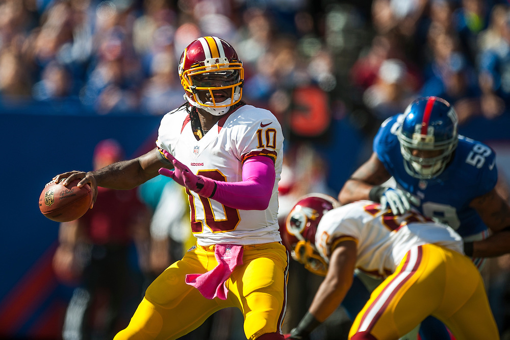 EAST RUTHERFORD, NJ - OCTOBER 21:  Quarterback Robert Griffin III #10 of the Washington Redskins looks to throw a pass during the game against the New York Giants at MetLife Stadium on October 21, 2012 in East Rutherford, New Jersey. (Photo by Rob Tringali) *** Local Caption *** Robert Griffin III