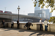 Londoners and office workers in the City of London - the capital's financial district - enjoy late summer temperatures on Fishmongers Hall Wharf overlooking the Shard skyscraper, London Bridge and the Thames river, on 10th October 2018, in London, England.