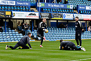 Toby Sibbick (20) of AFC Wimbledon, George Long (1) of AFC Wimbledon and Joe McDonnell (24) of AFC Wimbledon during the EFL Sky Bet League 1 match between Portsmouth and AFC Wimbledon at Fratton Park, Portsmouth, England on 26 December 2017. Photo by Graham Hunt.