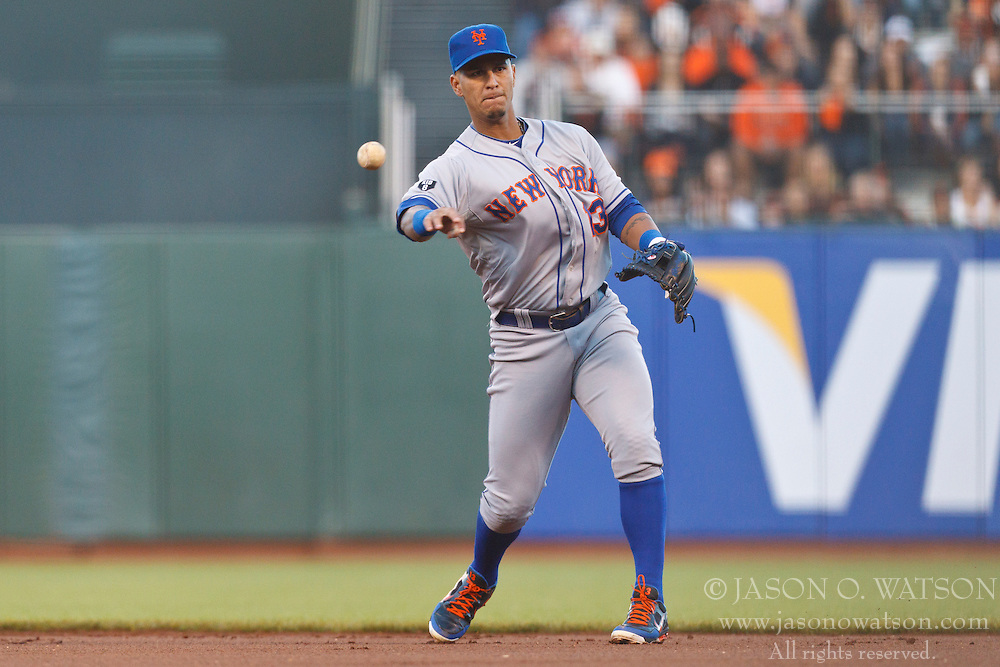 SAN FRANCISCO, CA - JULY 30: Ronny Cedeno #13 of the New York Mets throws to first base to complete a double play after catching a line drive against the San Francisco Giants during the first inning at AT&T Park on July 30, 2012 in San Francisco, California. (Photo by Jason O. Watson/Getty Images) *** Local Caption *** Ronny Cedeno
